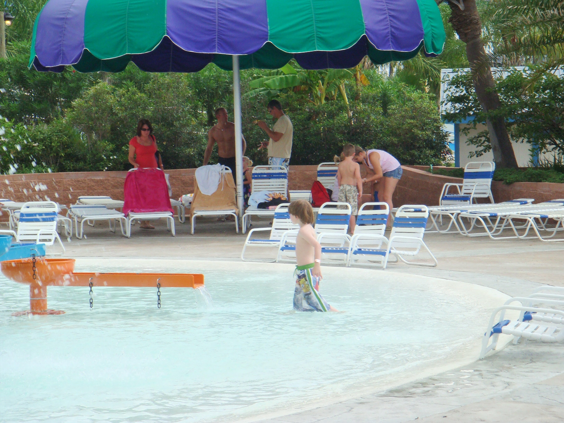 kid playing in shallow pool