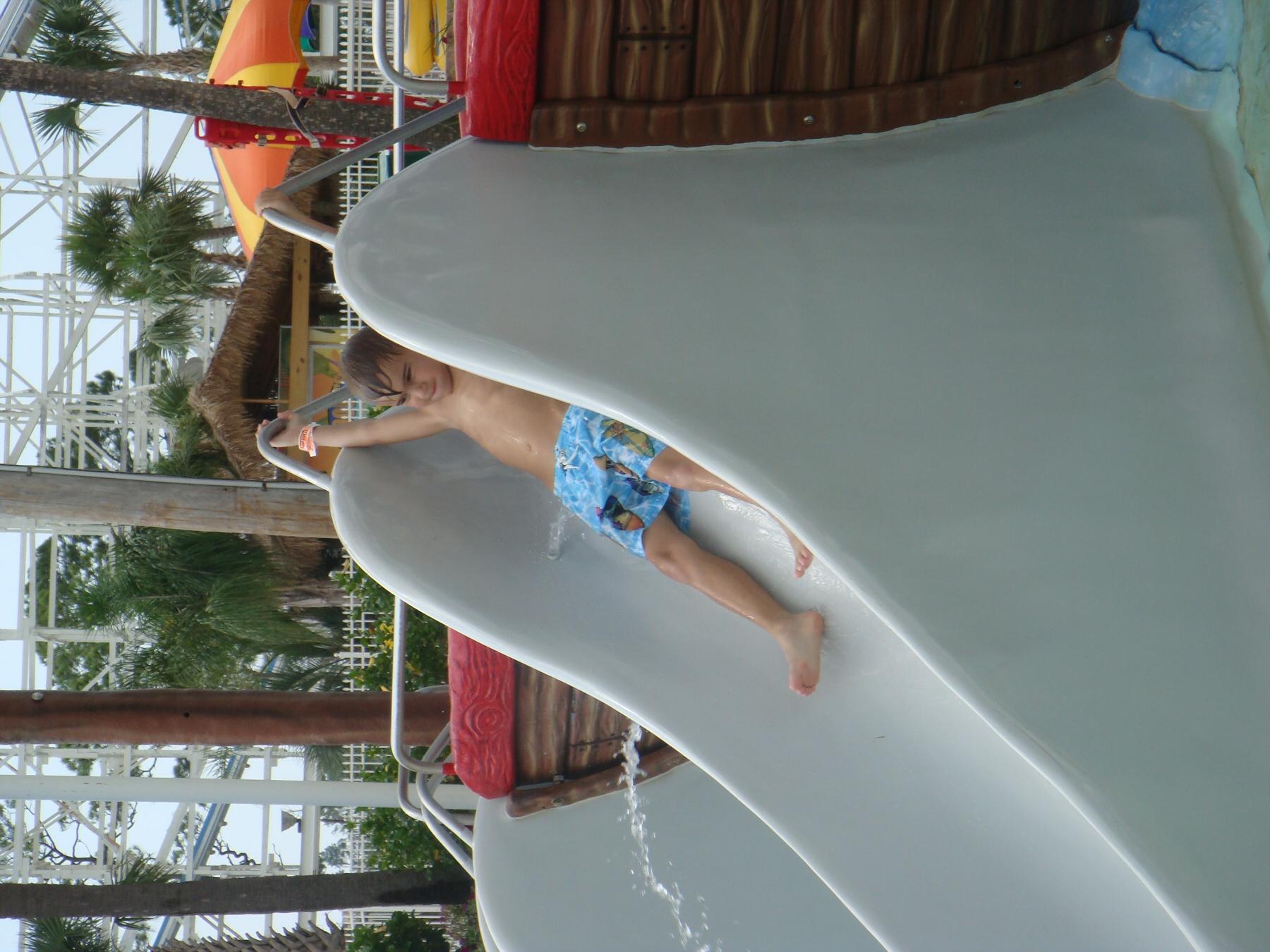 kid going down slide