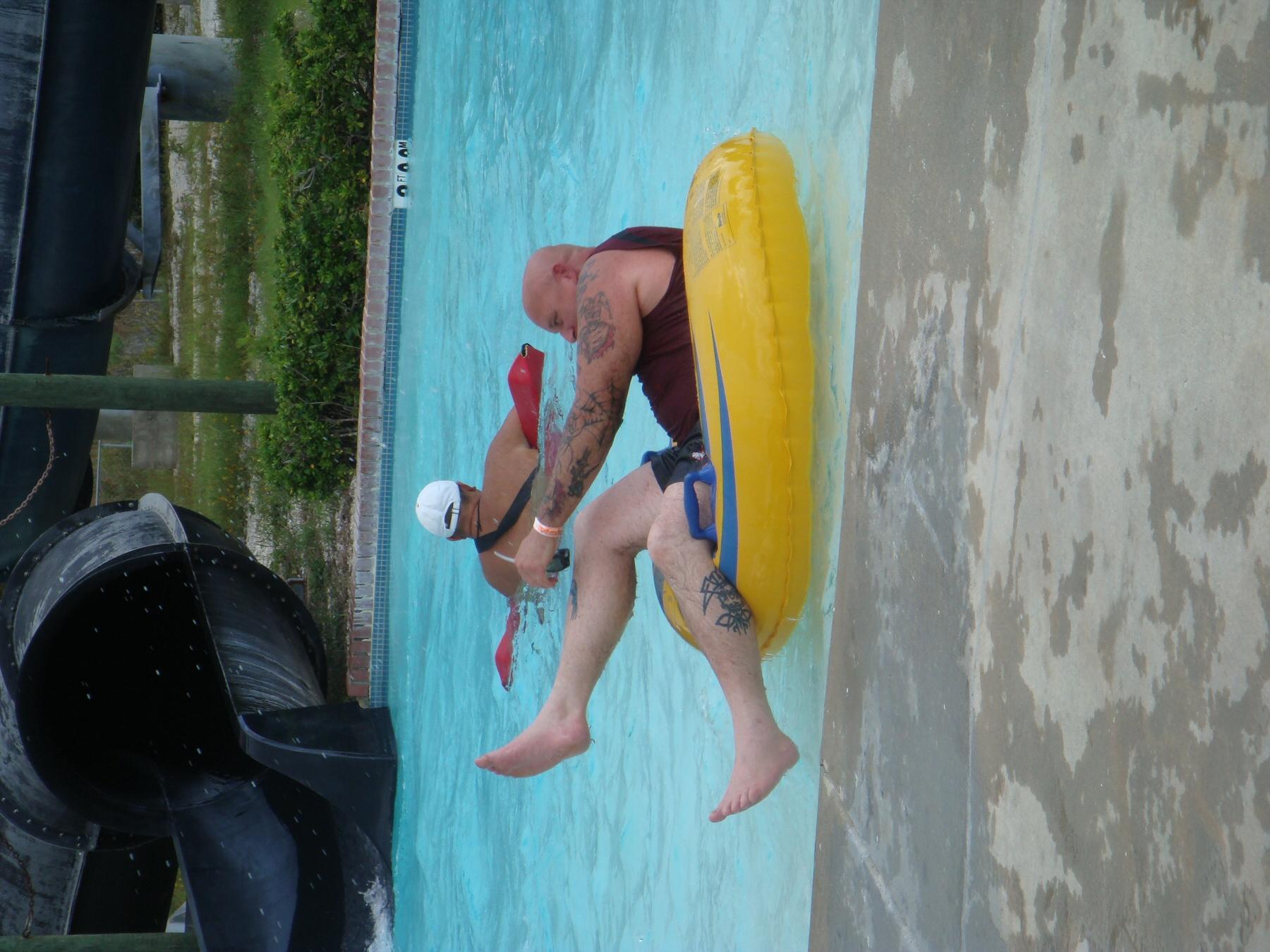 man floating in pool