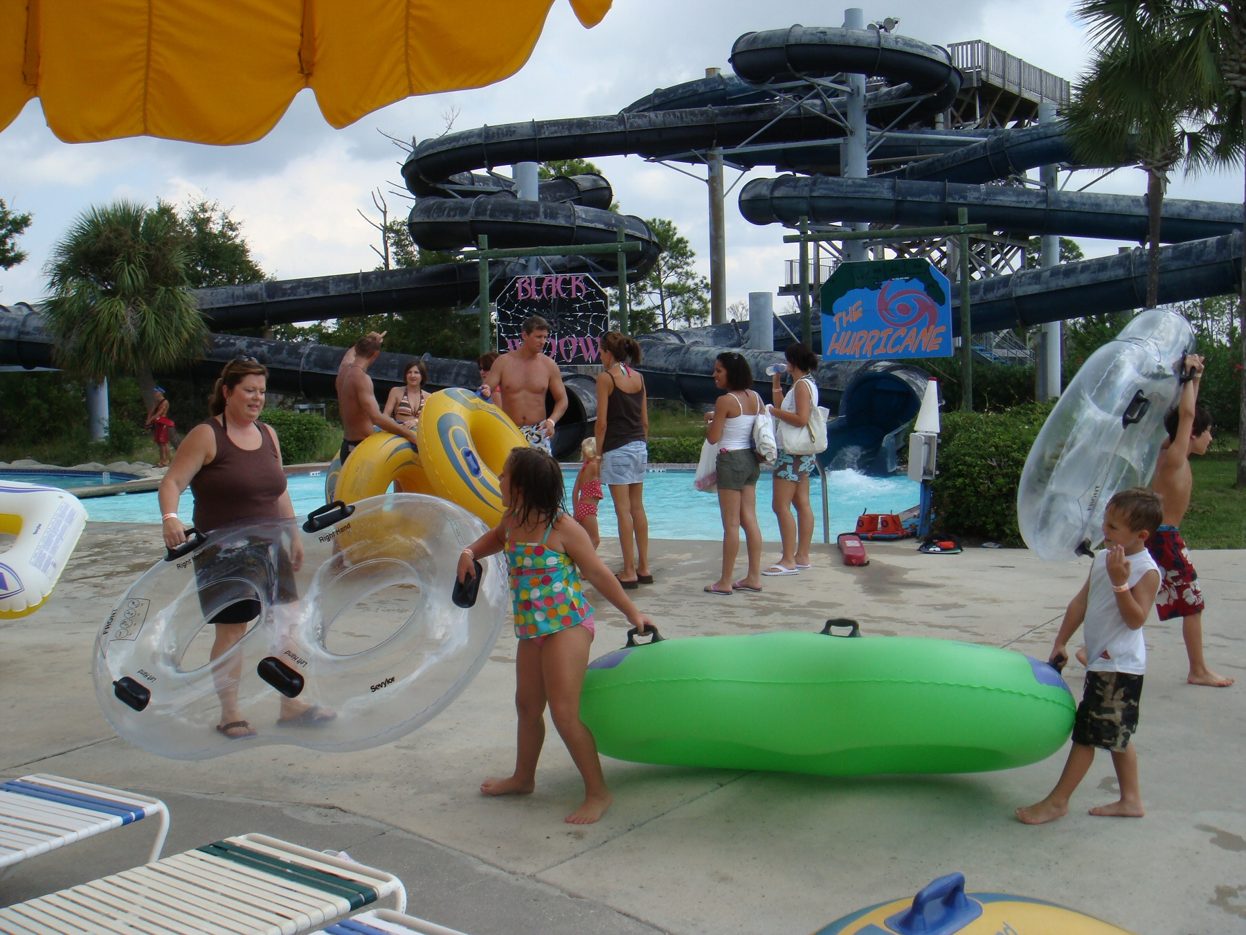 kids walking with pool floats