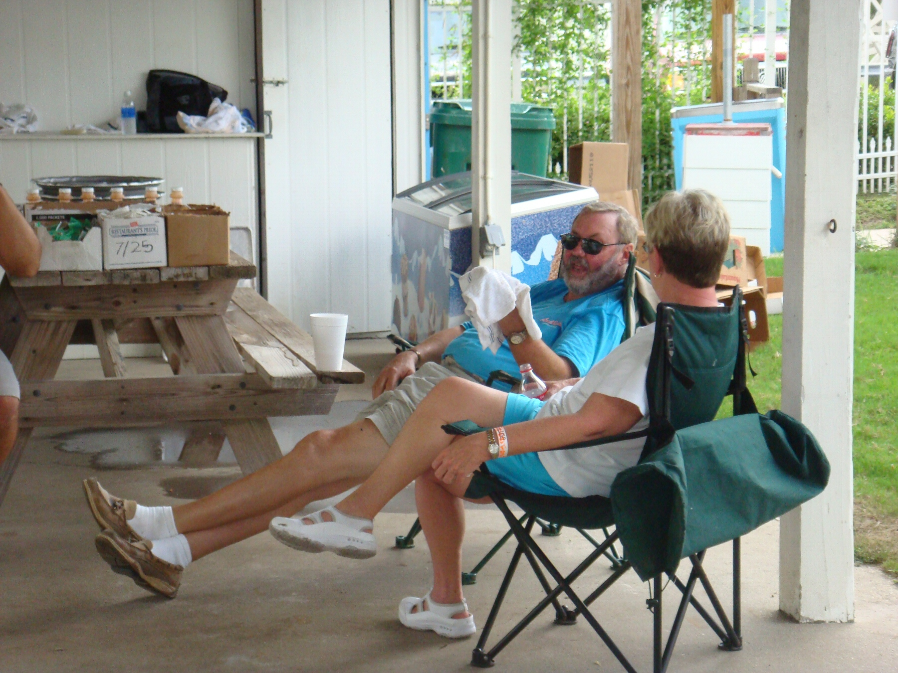man and woman sitting in folding chairs