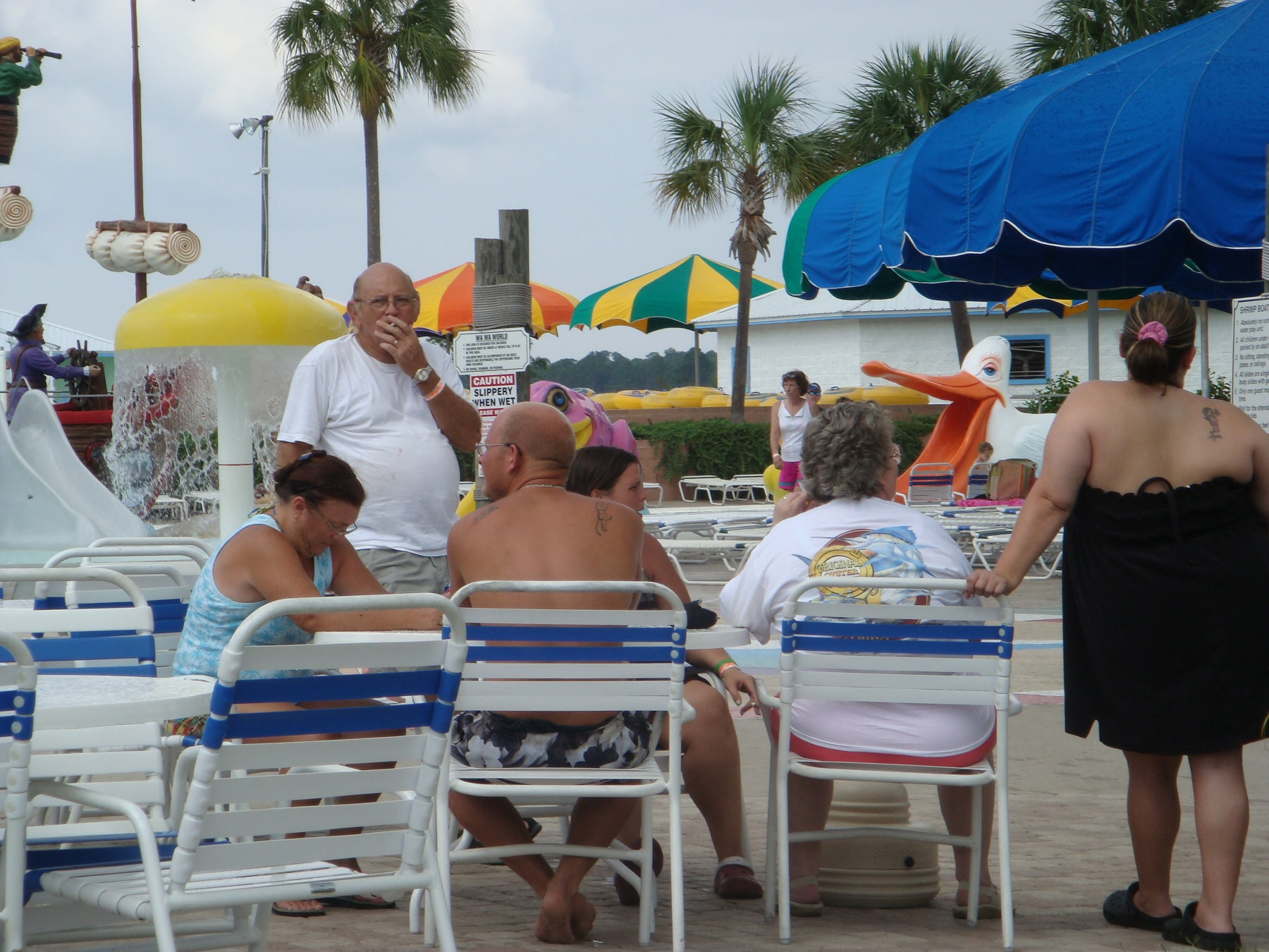 people sitting together at water park