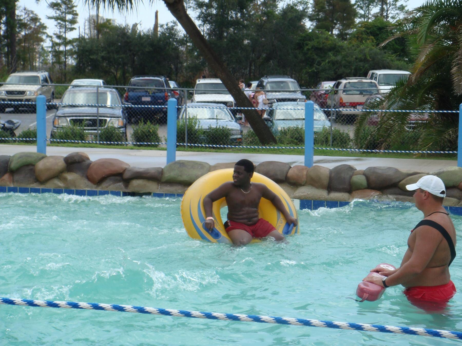 kid floating on raft in pool