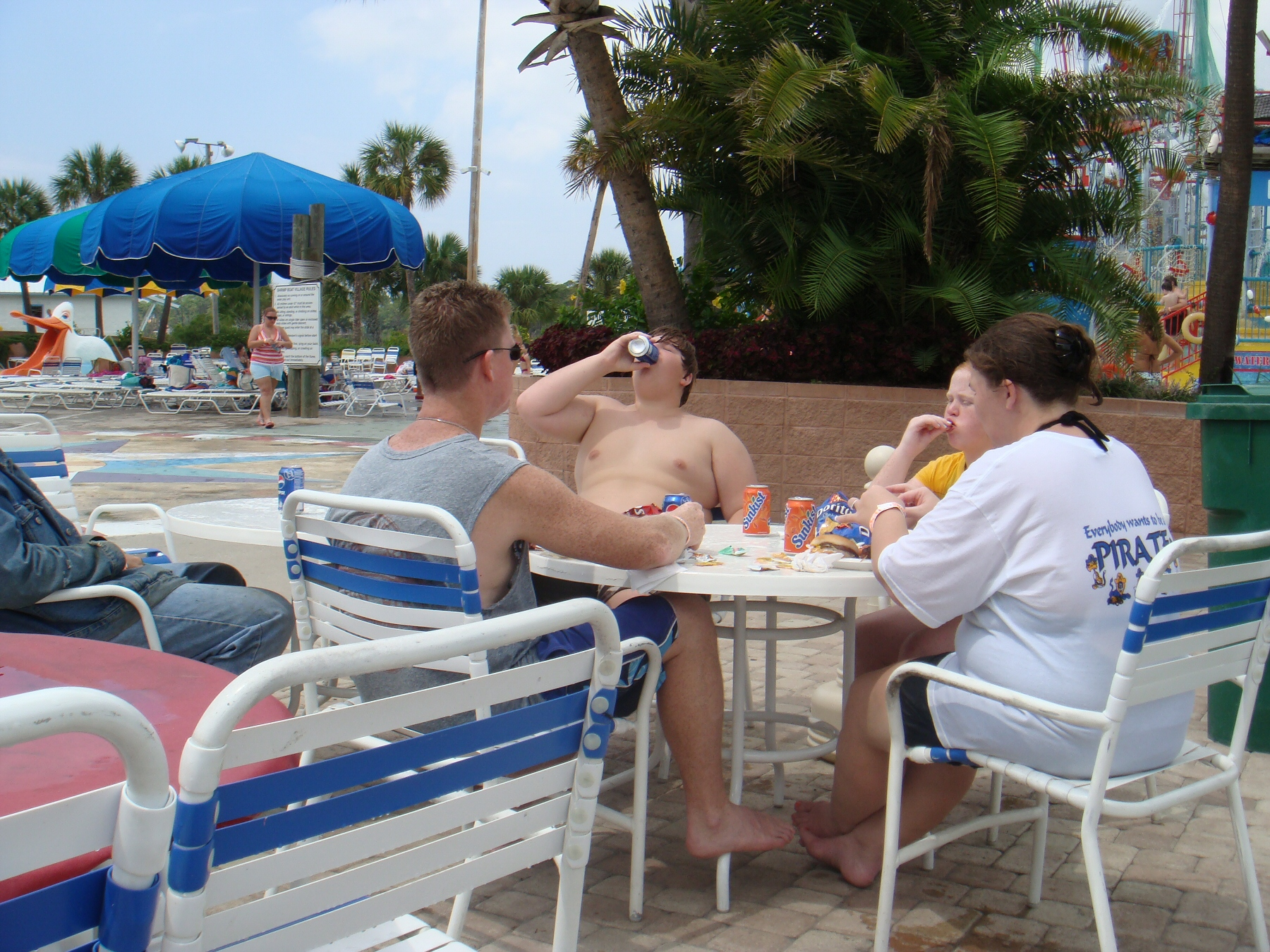 people drinking soda at water park