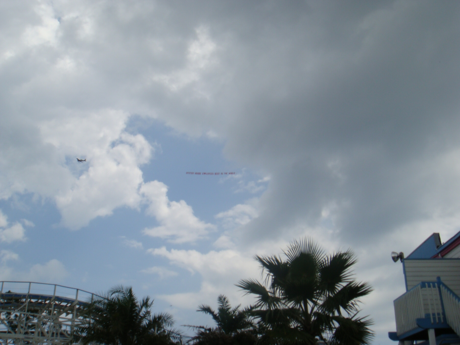 airplane flying over waterpark with banner