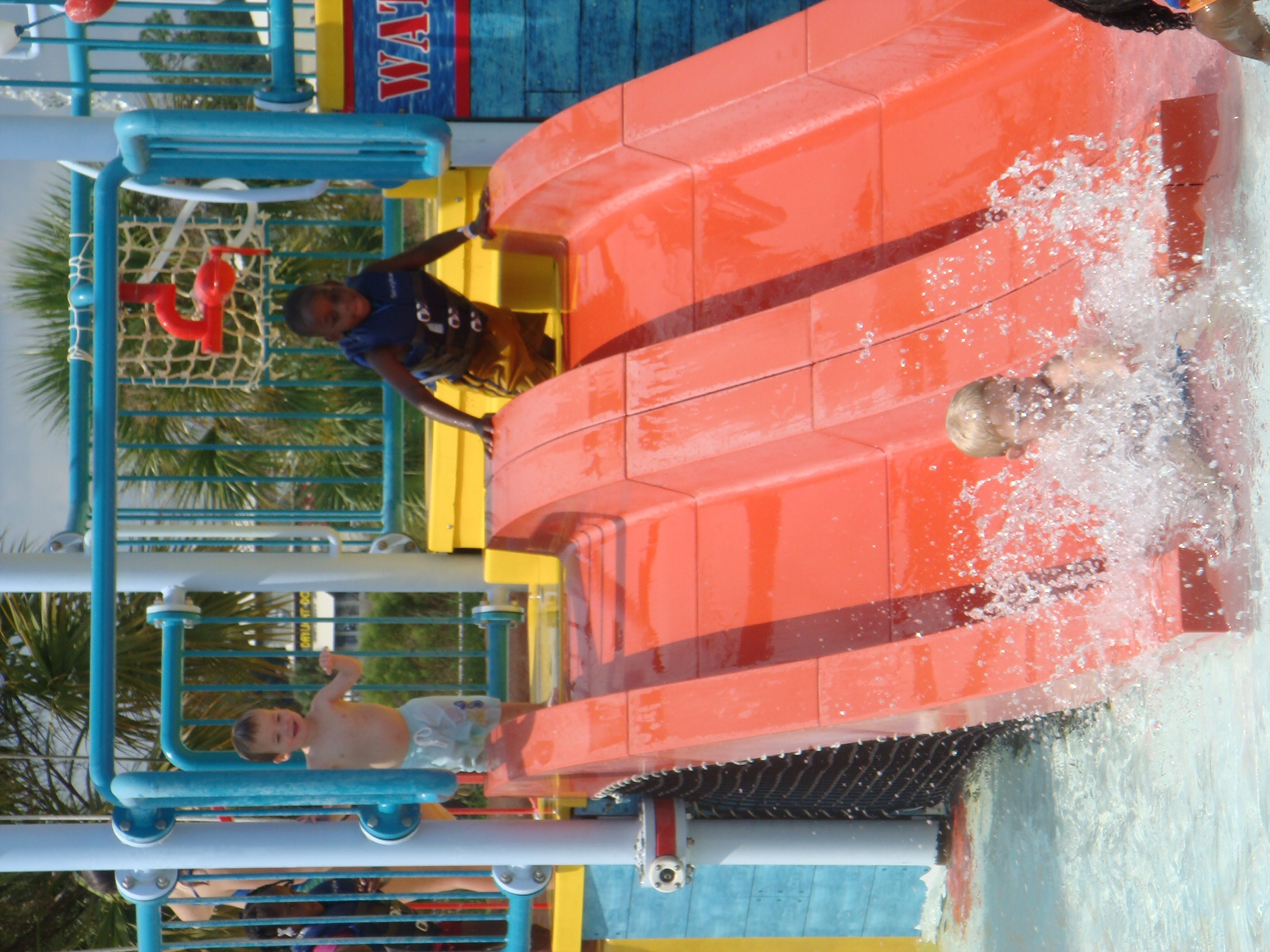 kids going down water slide