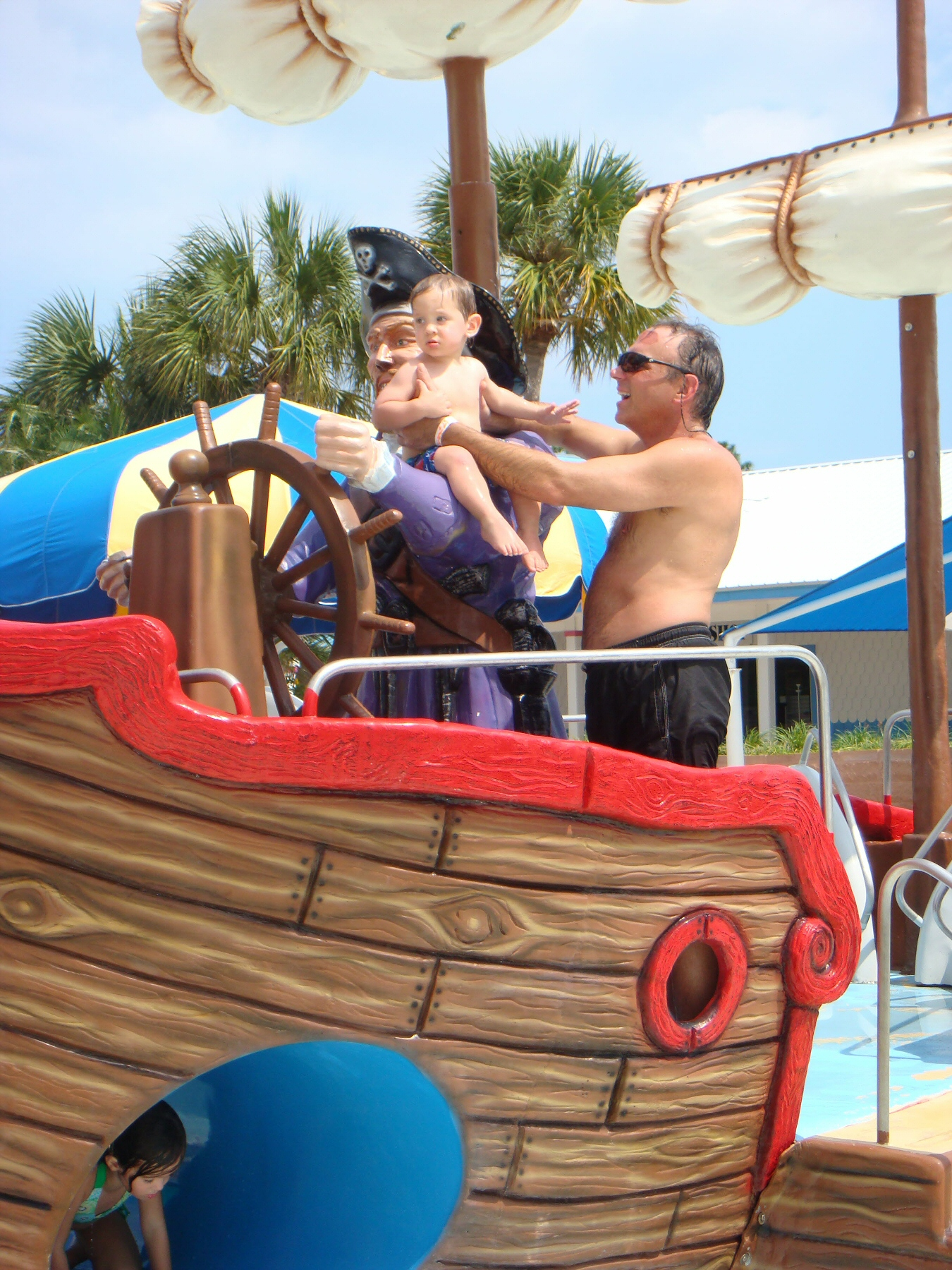 man with child in water park