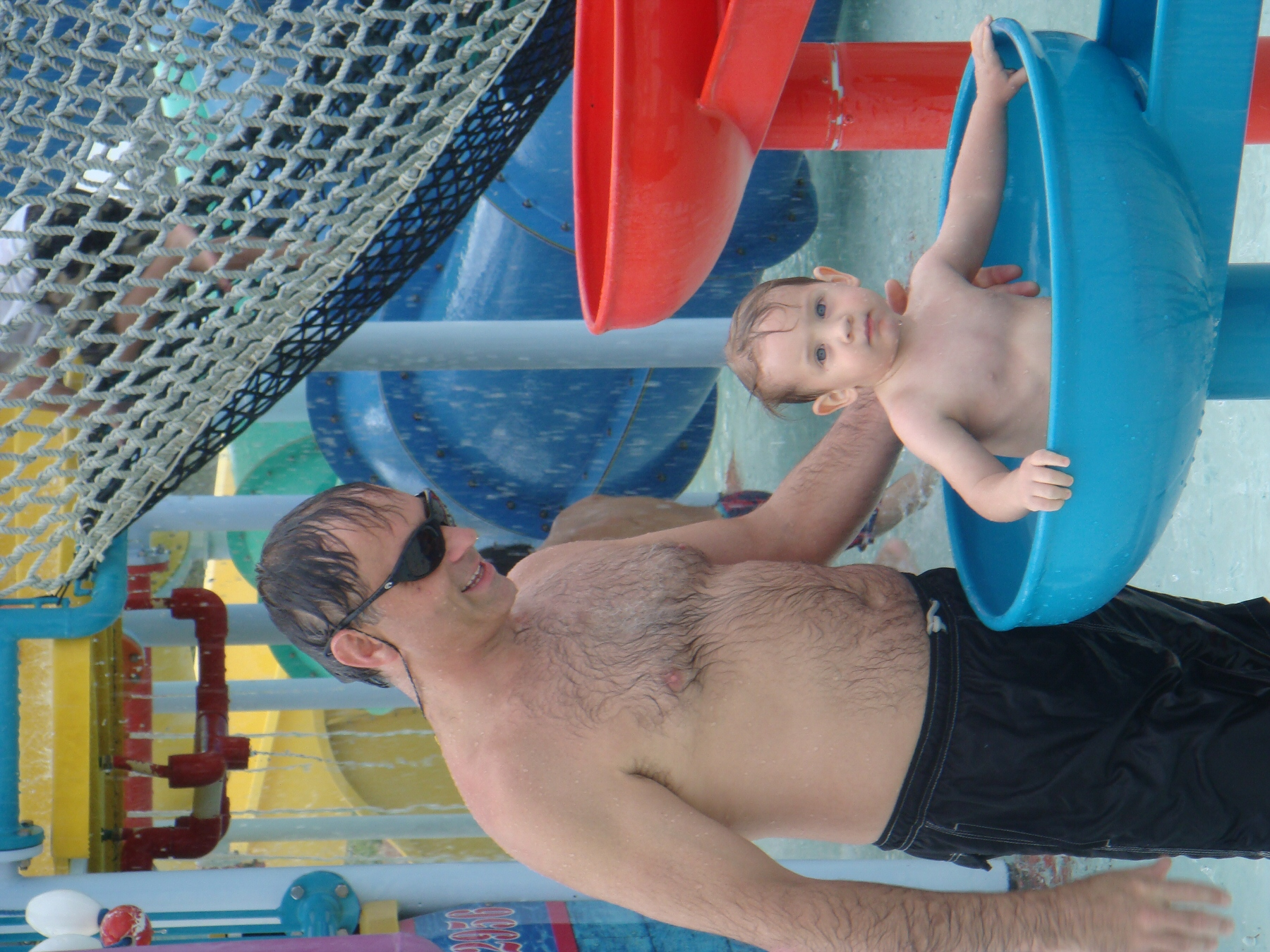 man and child at water park