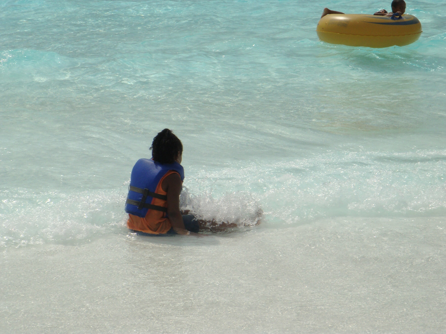 child in wave pool