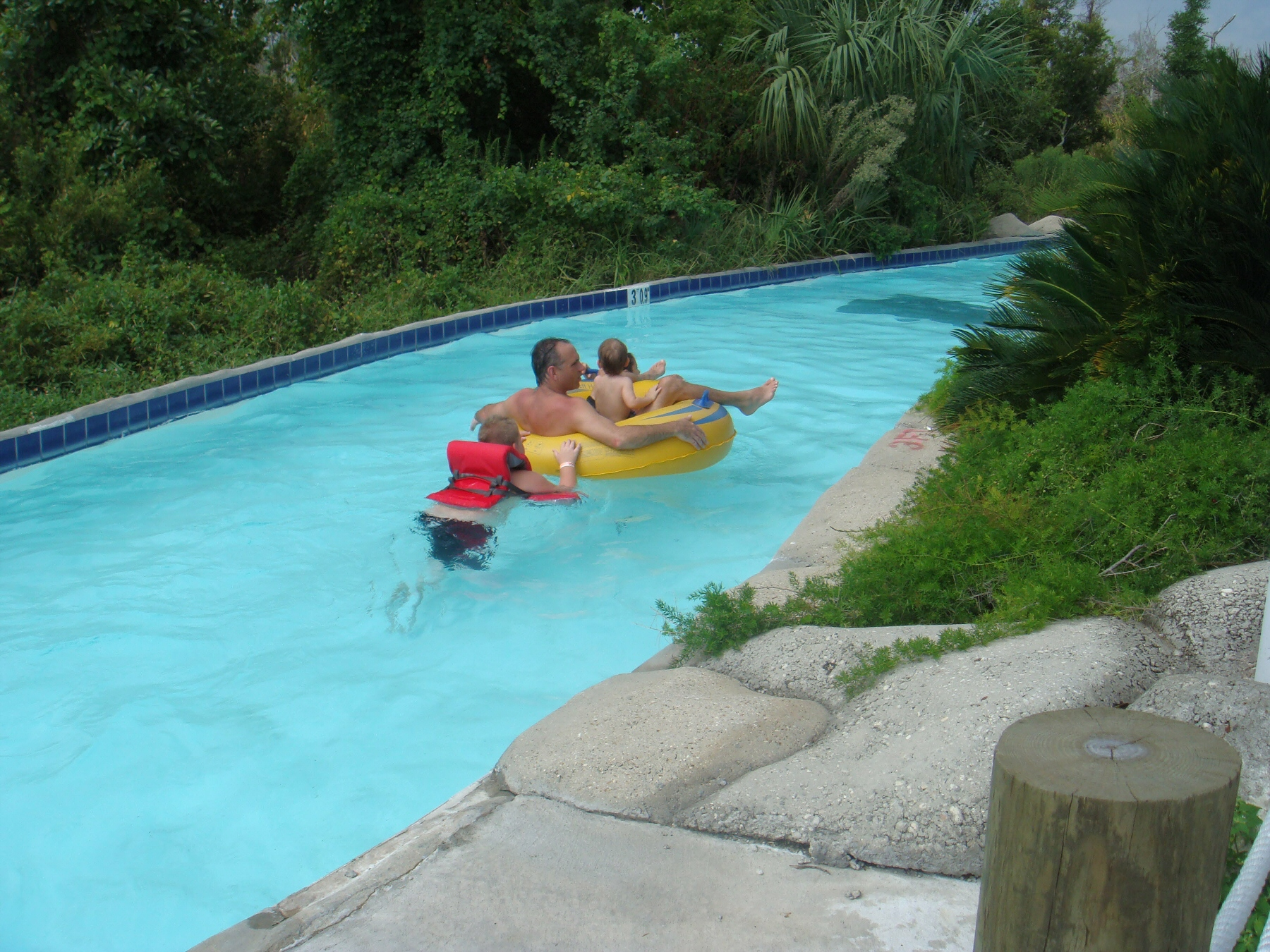 group of people floating down lazy river