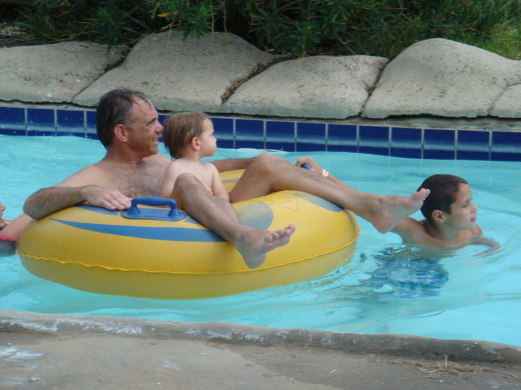 man with child on lazy river