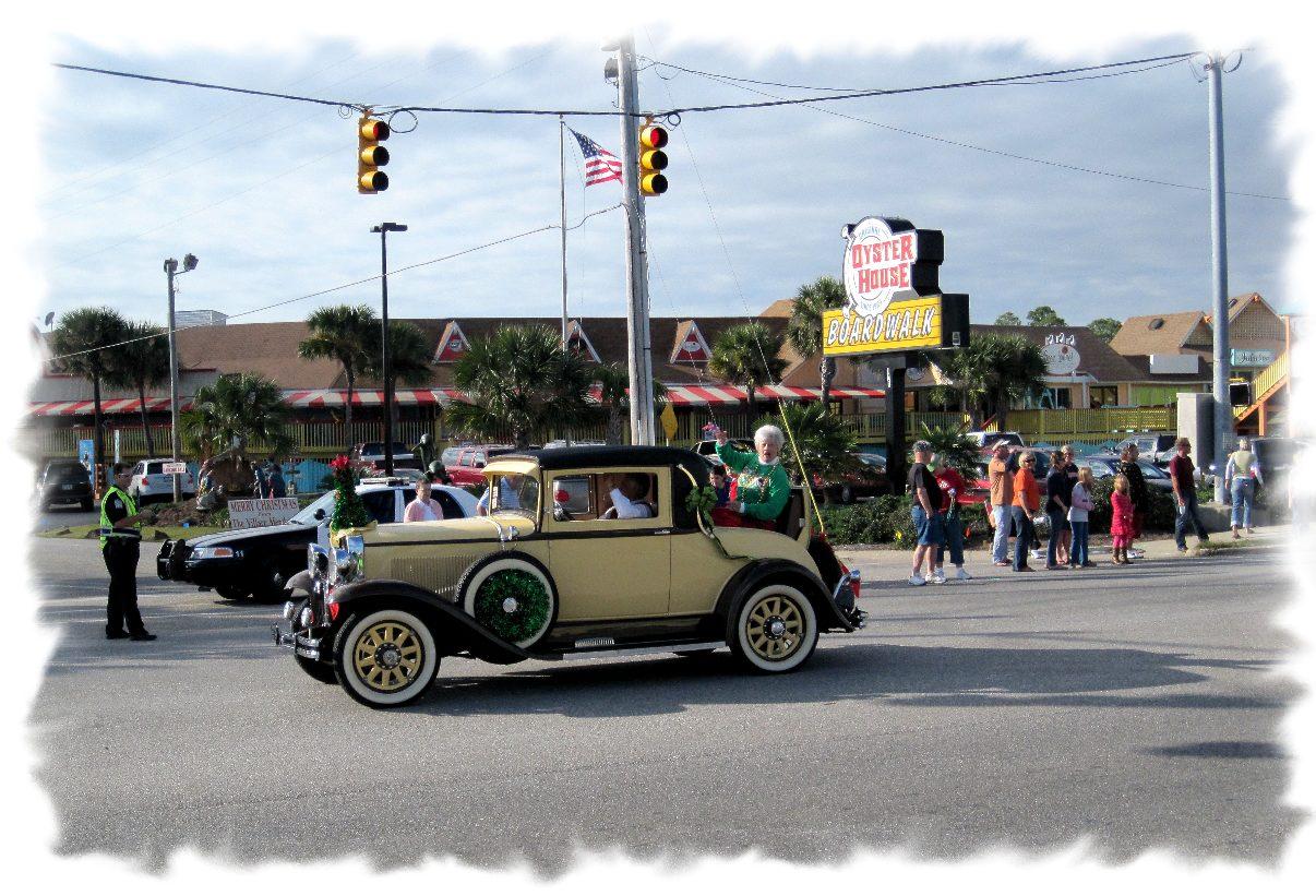 antique car driving in parade