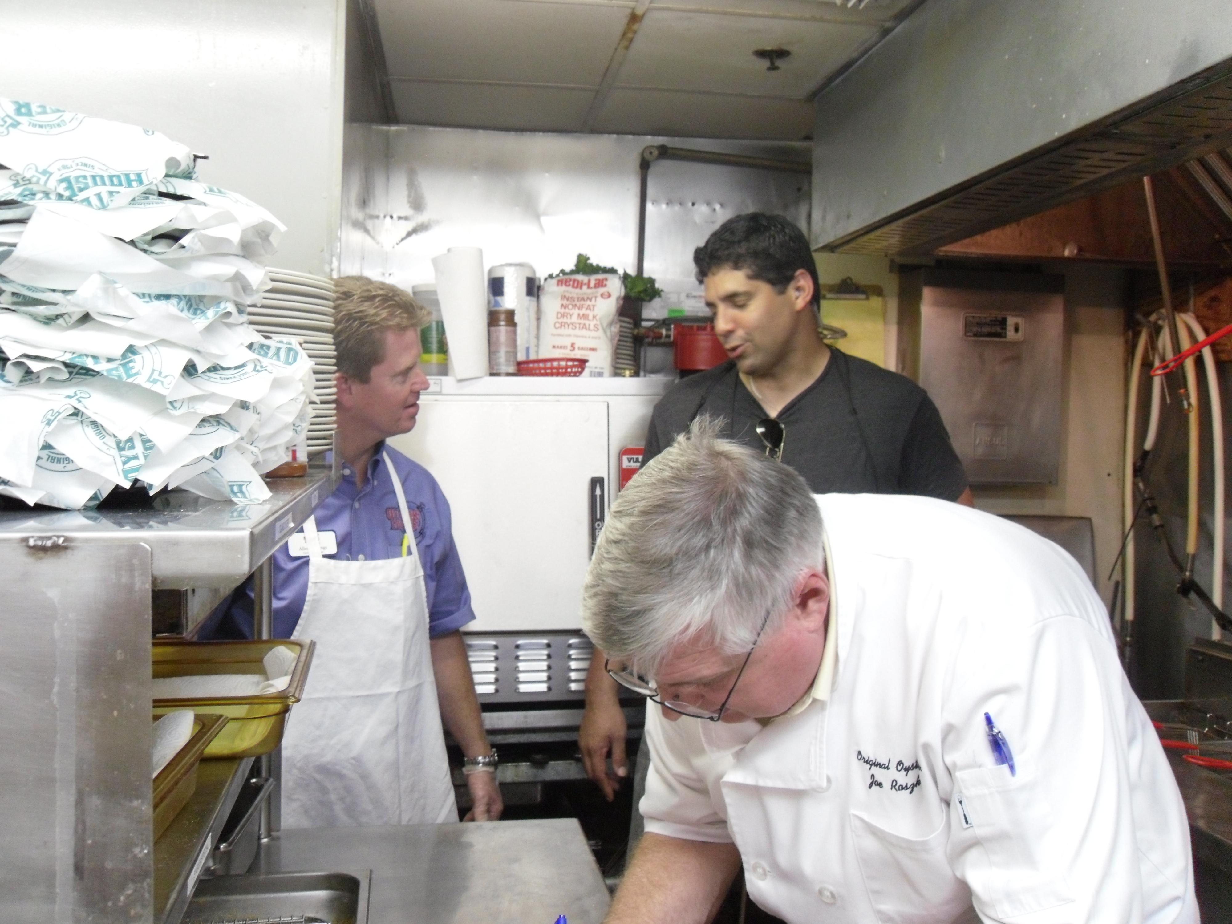 three men in kitchen