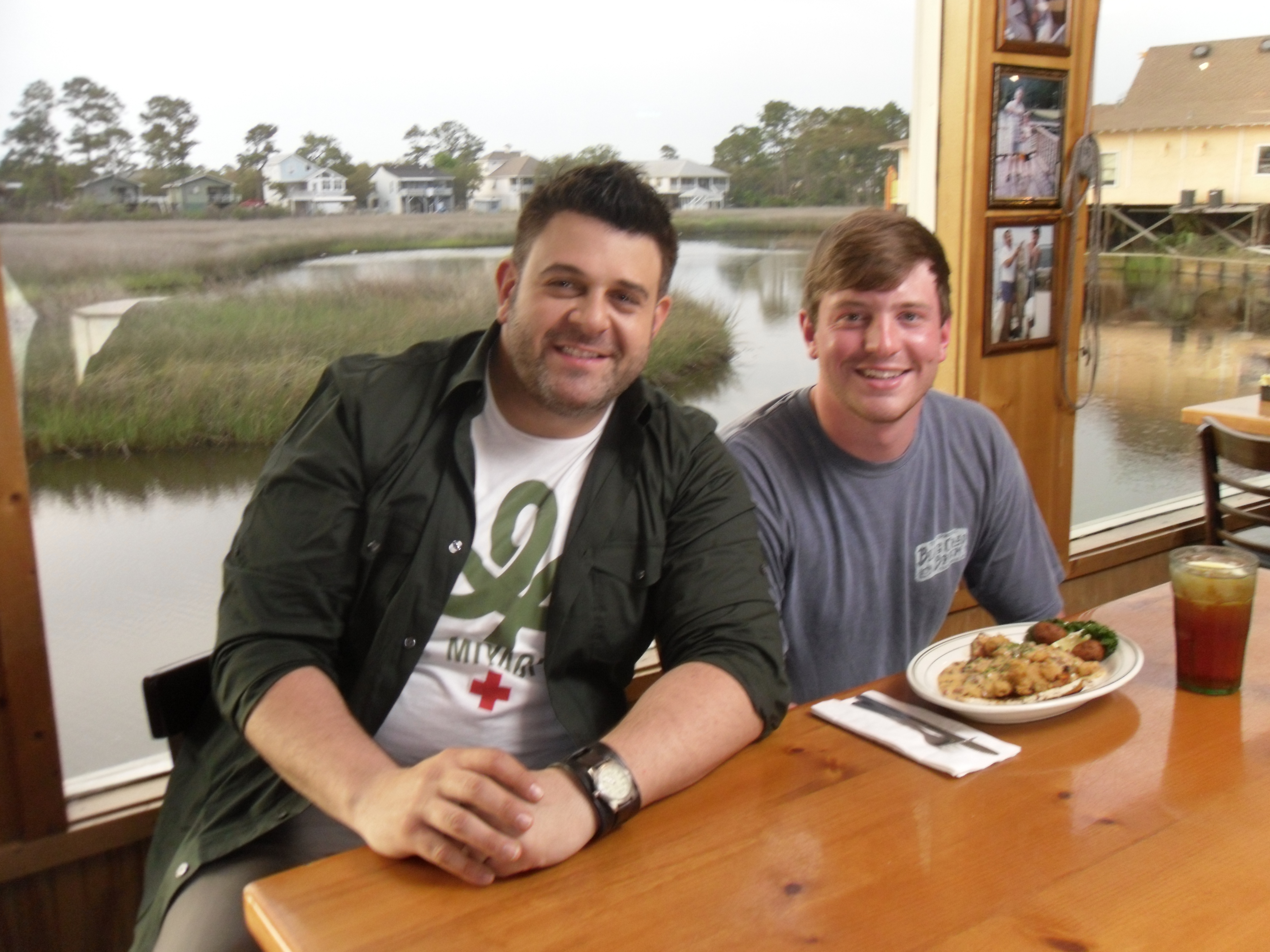 Adam Richman from Man vs. Food, American food reality television series, joins Josh Roszkowski, son of the founder Joe, at the Gulf Shores restaurant.
