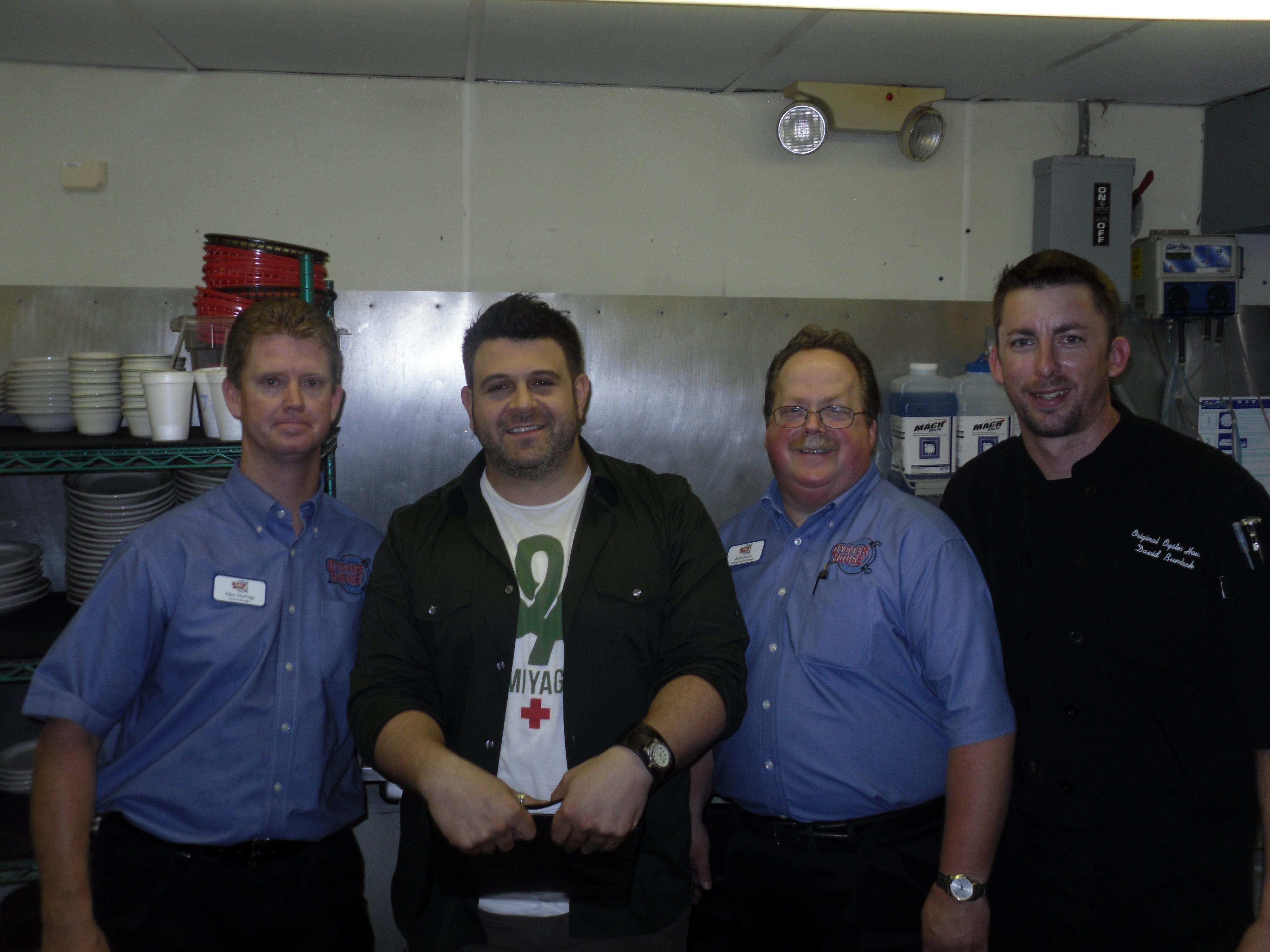 4 men in OOH kitchen