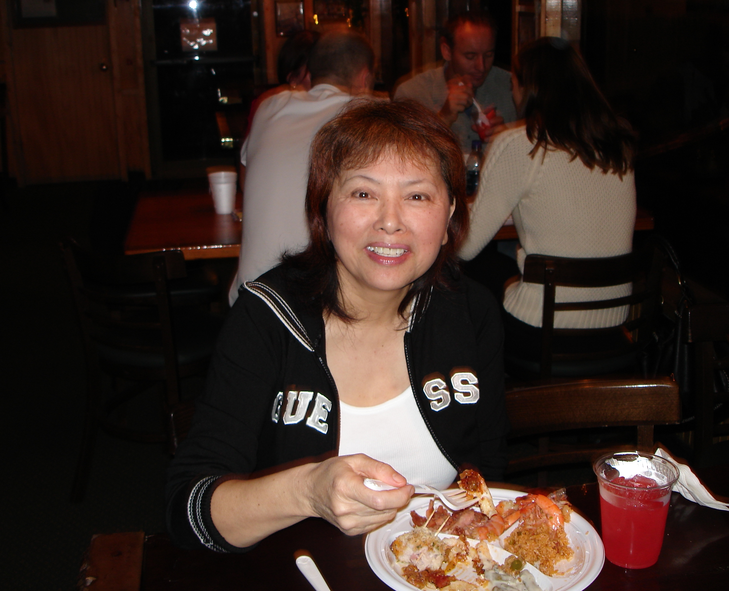 woman eating at christmas party at original oyster house