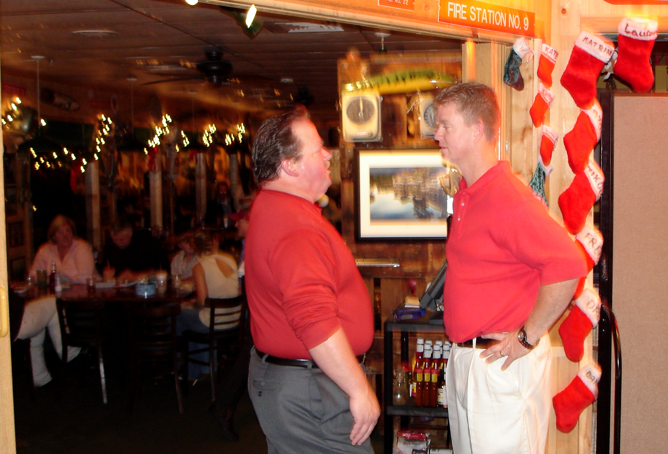two men talking at 2006 Gulf Shores x-mas party