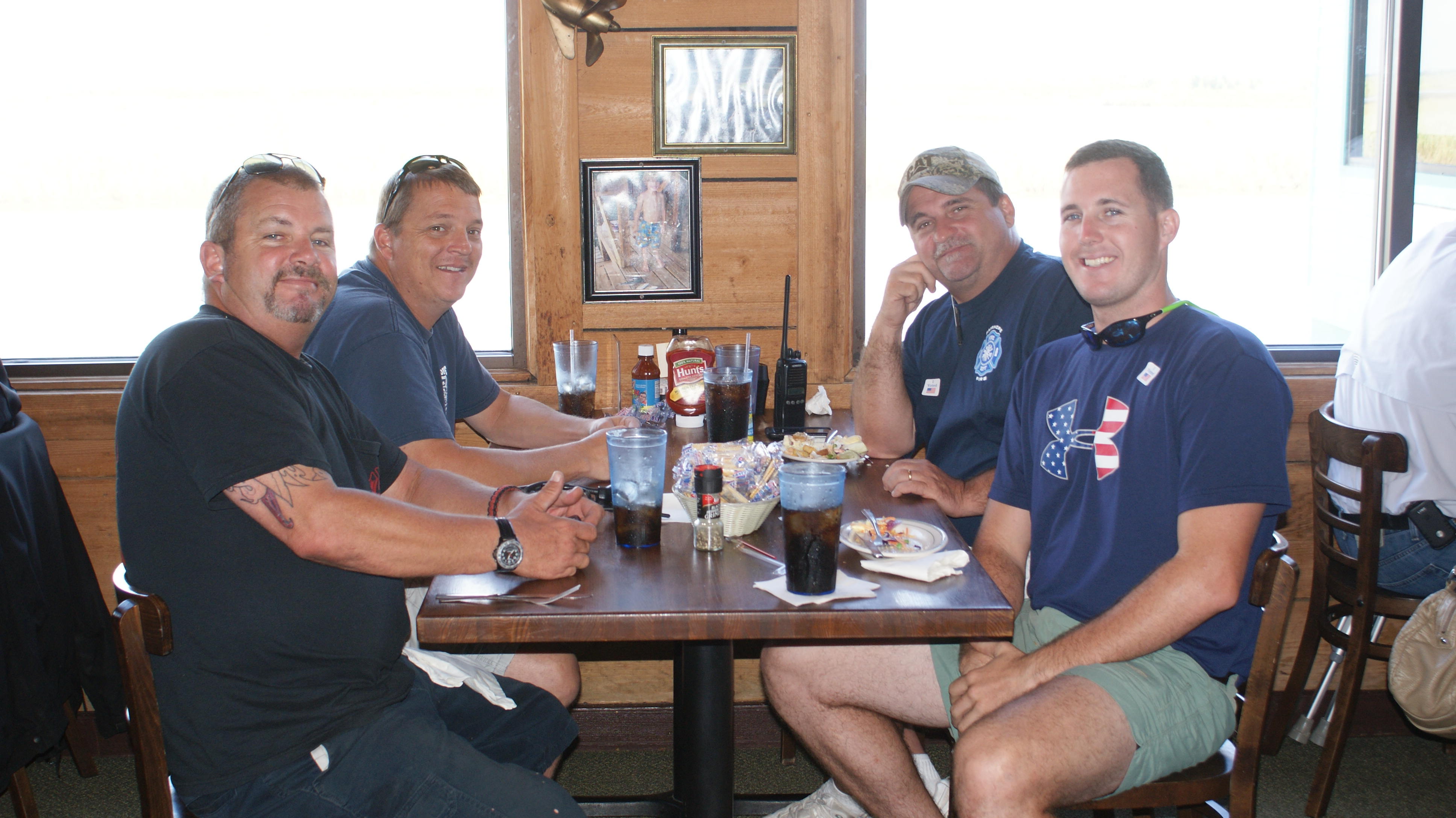 Men smiling for picture at Never Forget Lunch at Original Oyster House