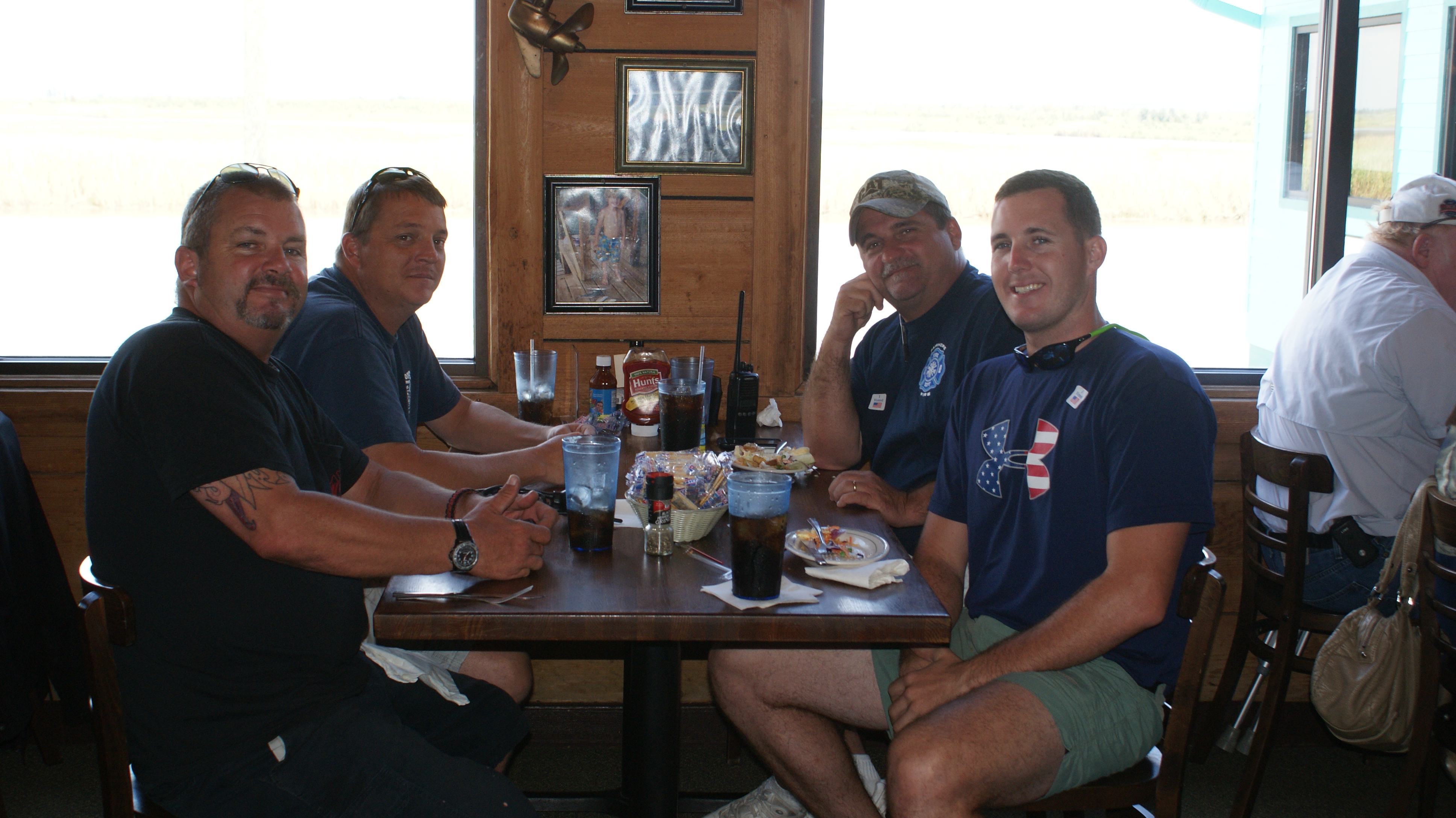 Servicemen enjoying lunch at Original Oyster House's never forget lunch