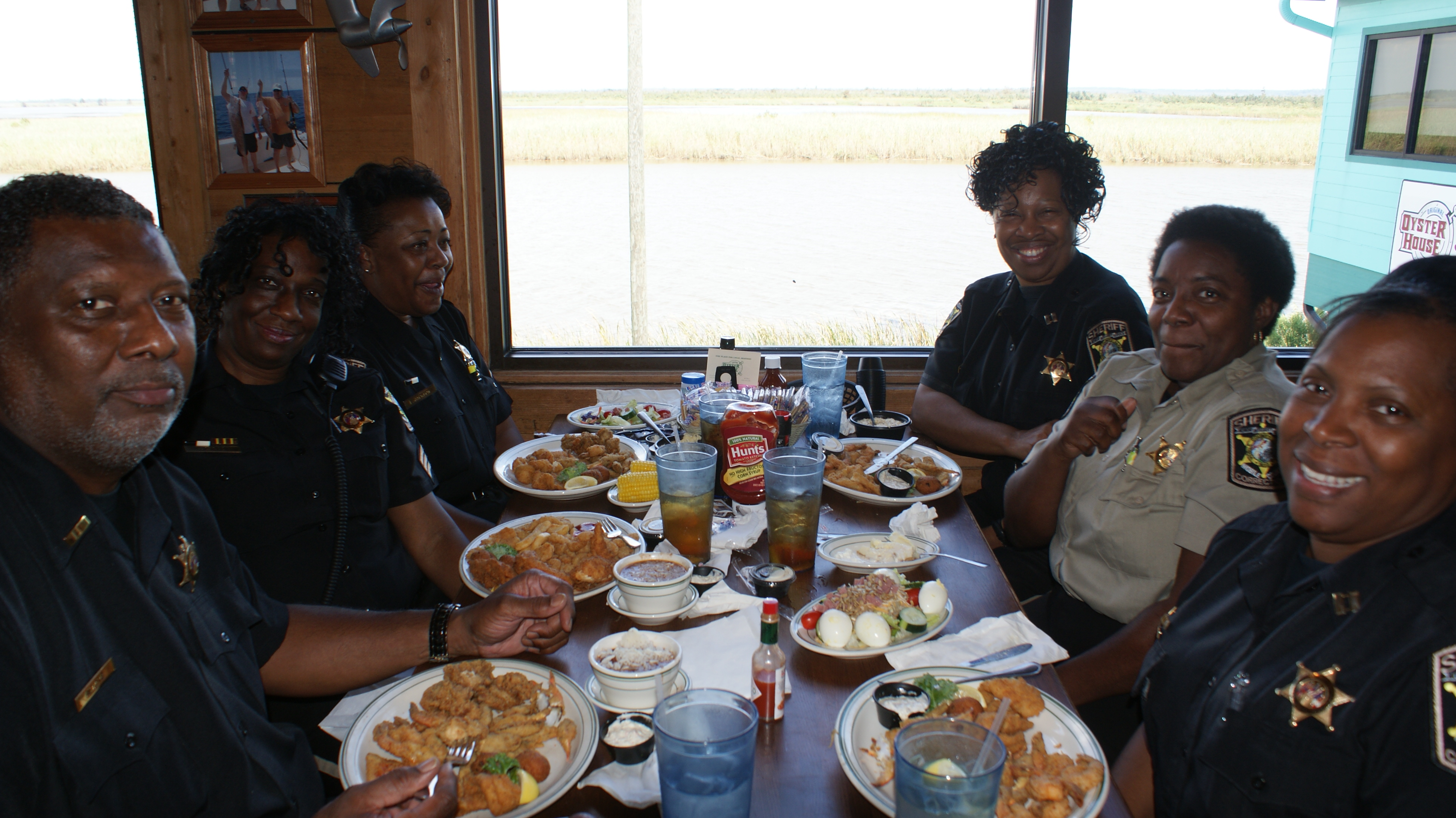 Police officers enjoying lunch at Original Oyster House's Never Forget lunch