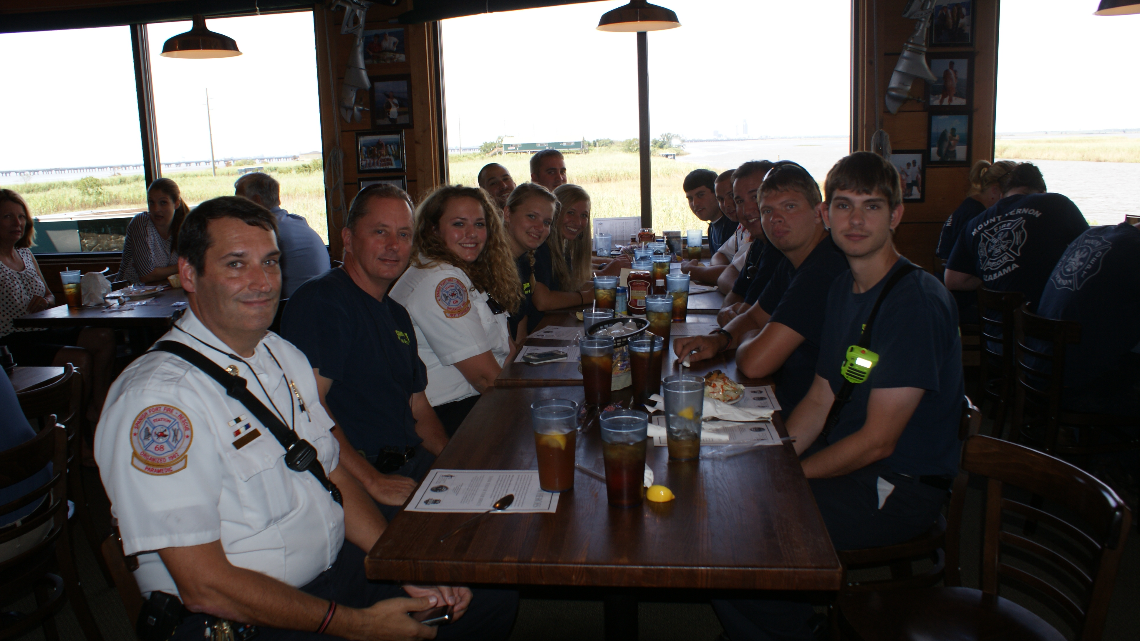 Group of people enjoying Never Forget Lunch at original oyster house