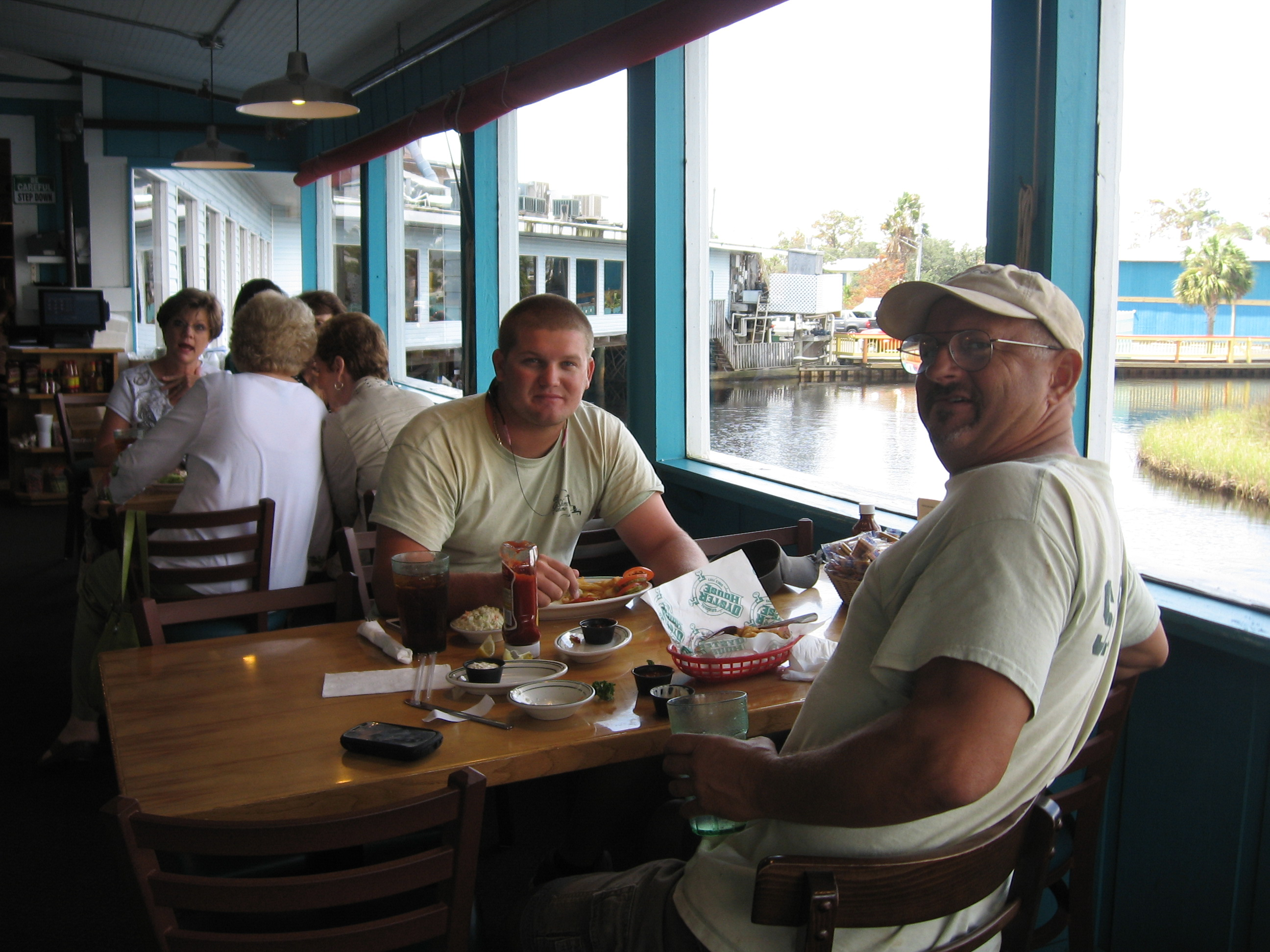 Two firefighters sitting at a table enjoying Original Oyster House lunch