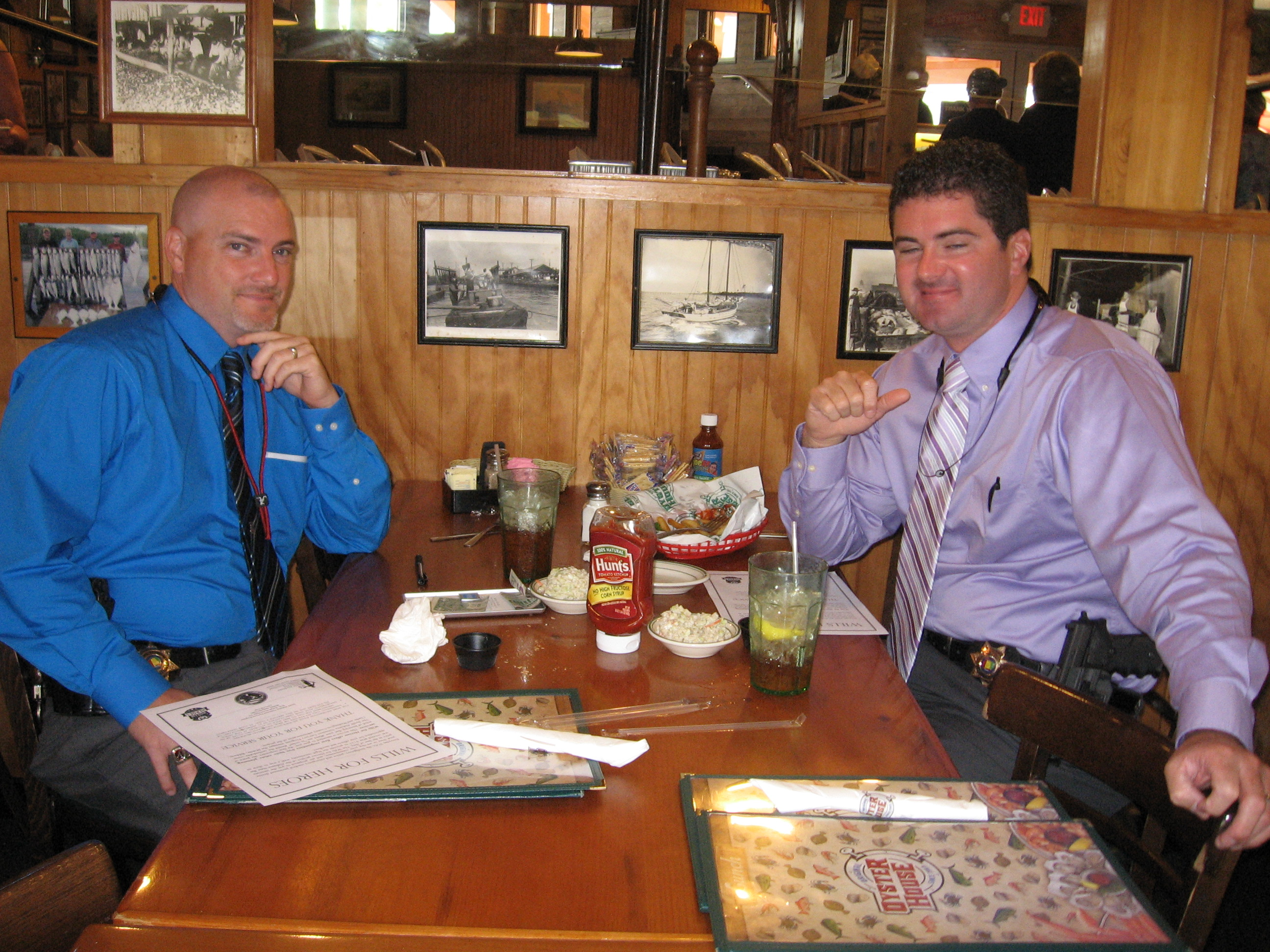 two men eating at Never Forget Lunch at Original Oyster House