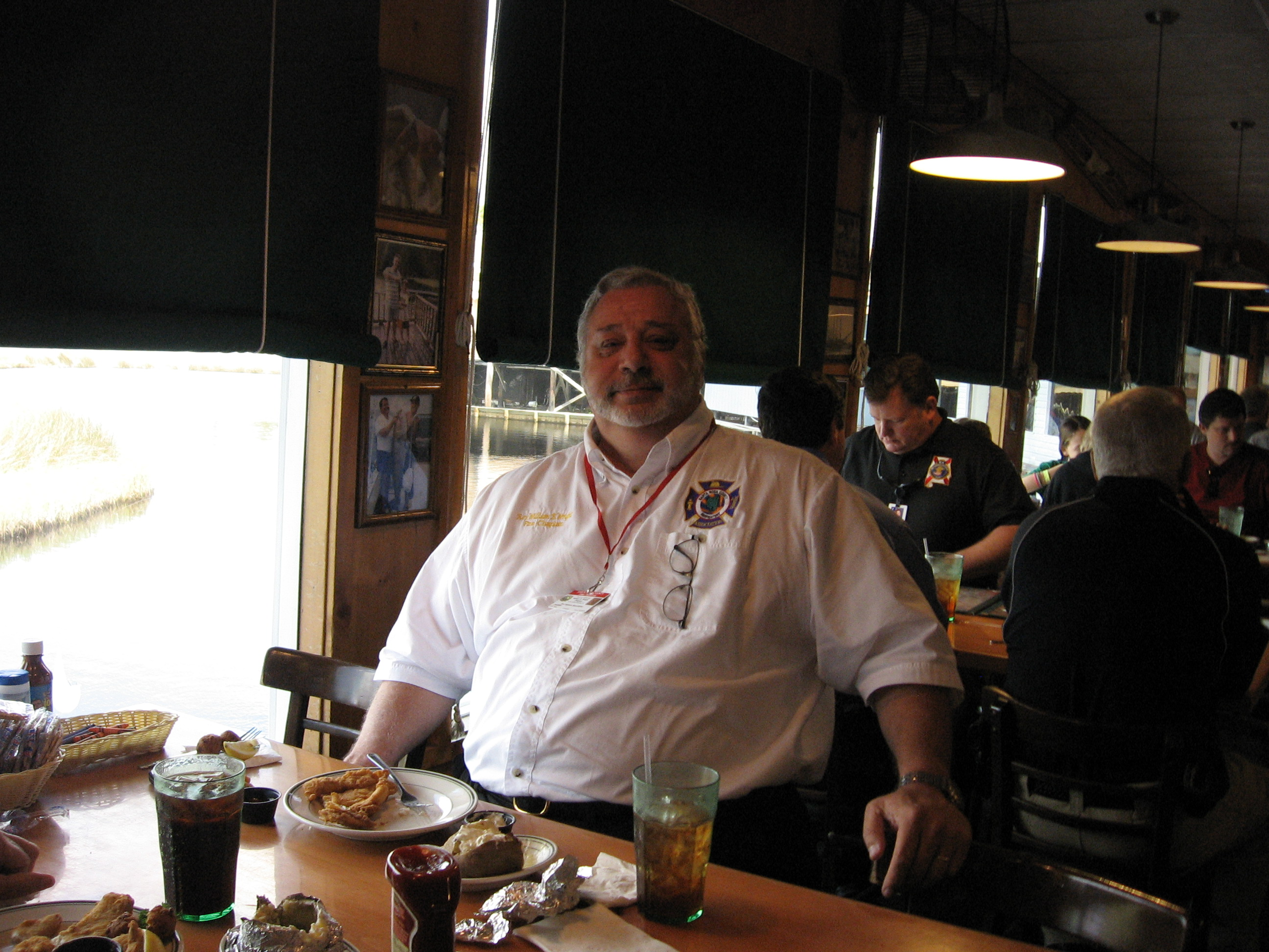 Fireman eating at Original Oyster House's Never Forget Lunch