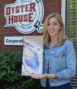 2018 Chelsea Garvin Spirit Scholarship winner Abi Waller pictured holding her artwork