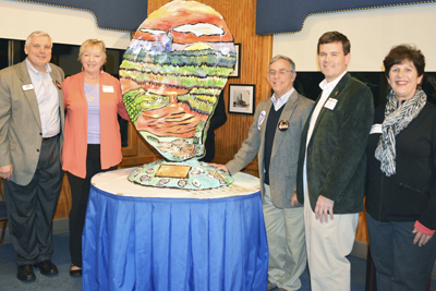 The first Oyster Trail Sculpture on the Eastern Shore being unveiled at the Original Oyster House on the Mobile Causeway