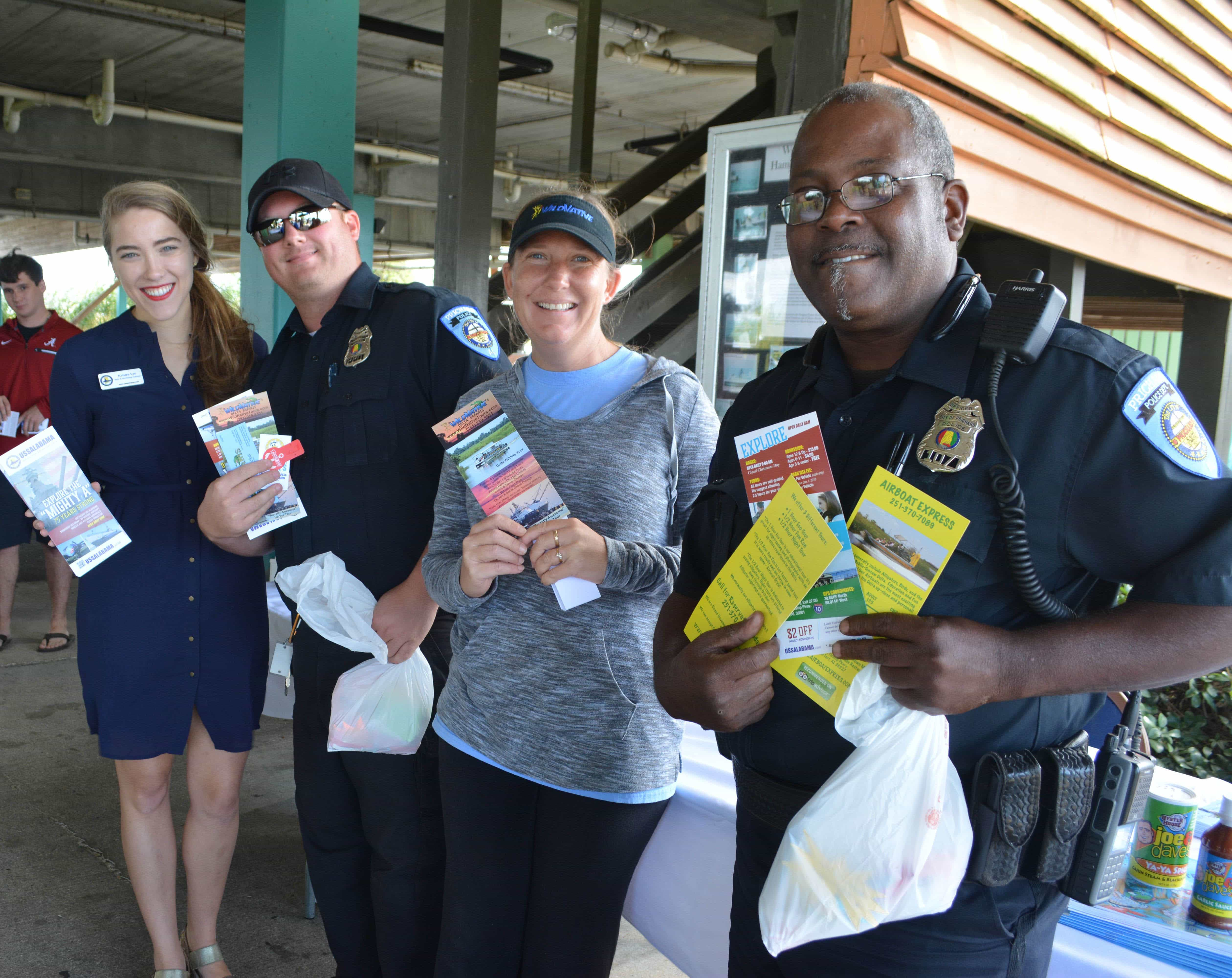 Prichard police officers stand with local vendors