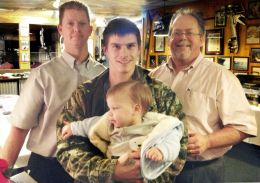 Allen Hastings, general manager; Ronald McCord, employee of the year, holding his son Brantley; and Bud Morris