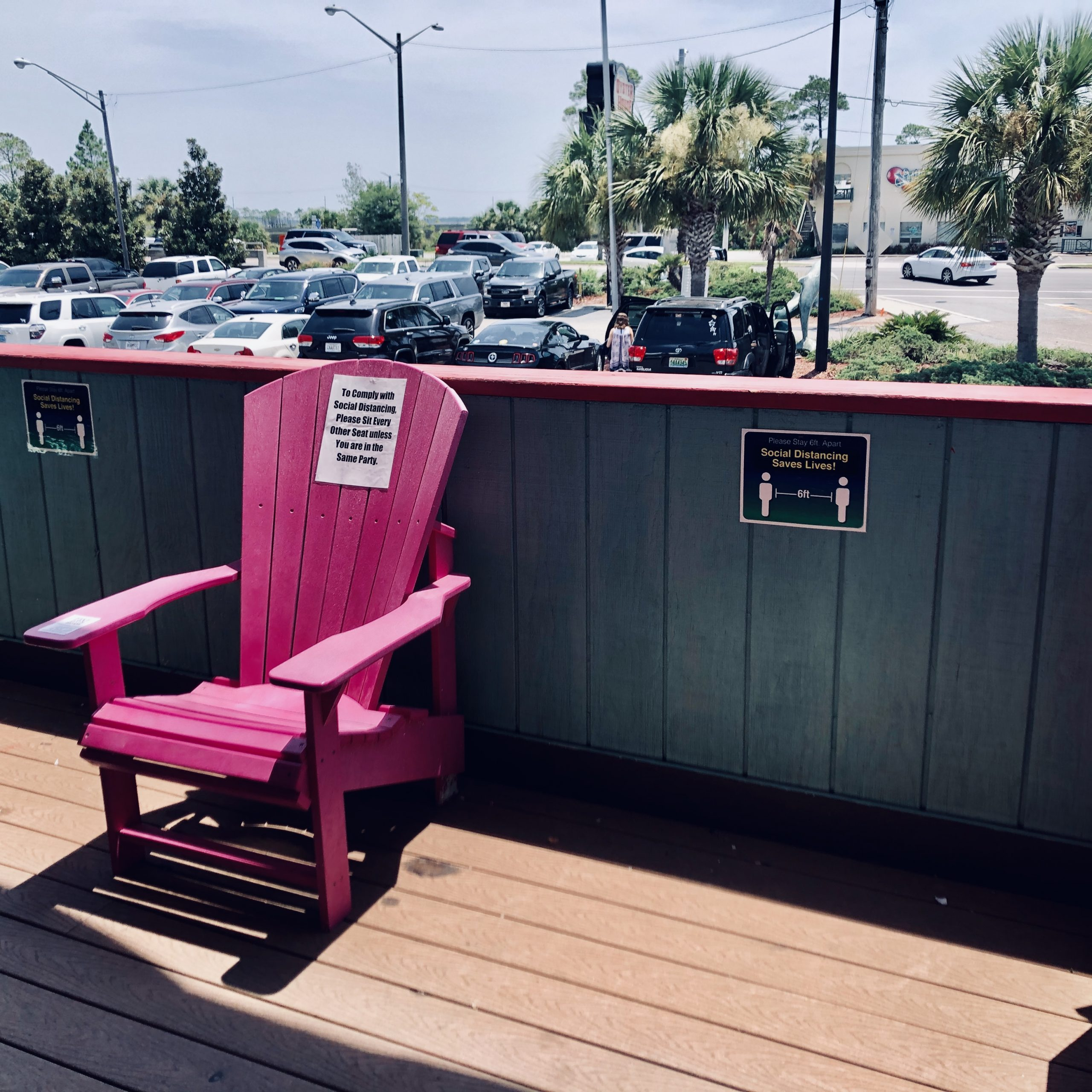 Pink Adirondack Chair with Social Distance Signs